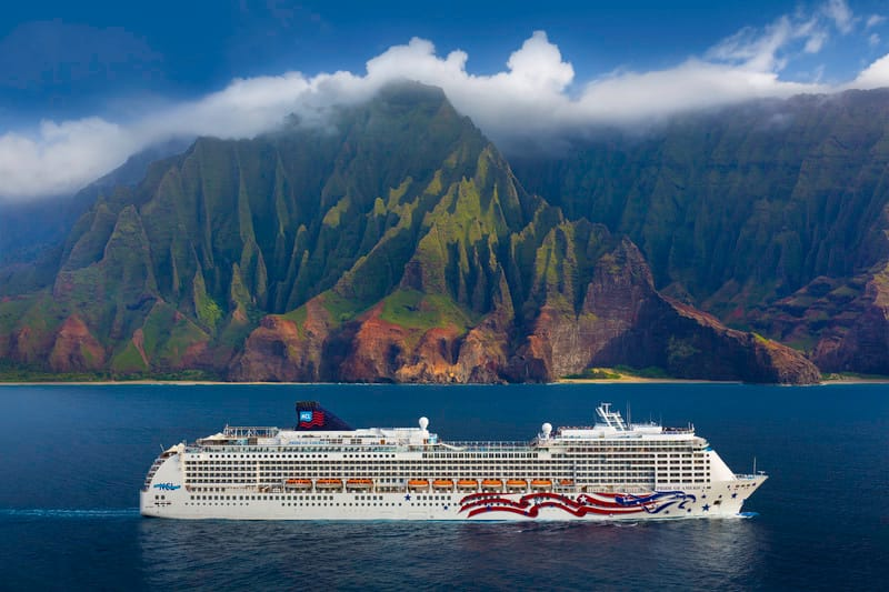 Pride of America cruise ship at sea sailing past the Na Pali Coast.