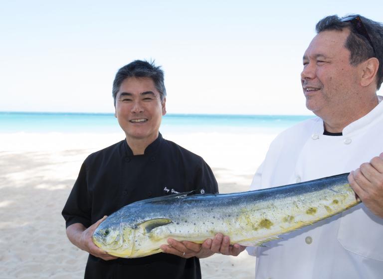 Roy Yamaguchi holding a fish