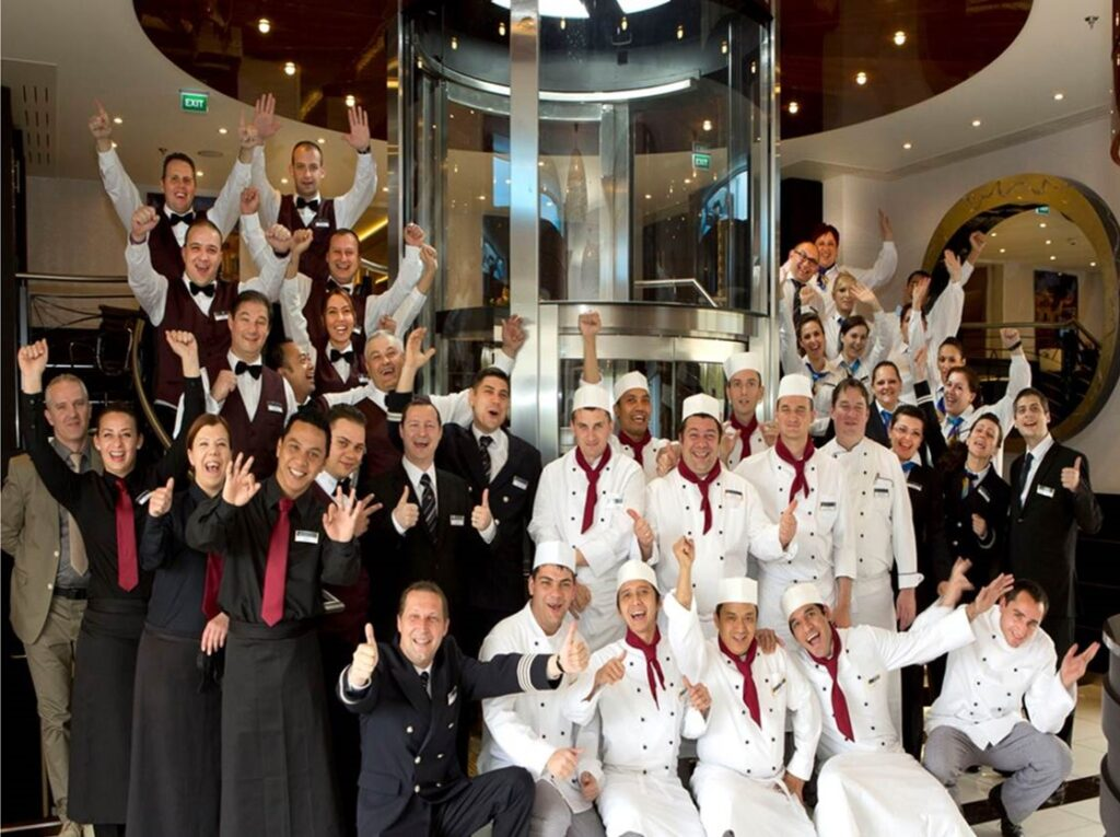 Golf Ahoy Danube River Golf Cruise AmaMagna chefs and waiters group welcome aboard thumbs up