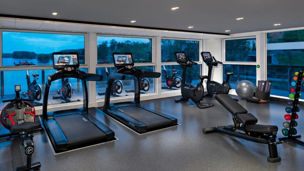 Golf Ahoy Danube River Golf Cruise AmaMagna fitness equipment in gym with a view outside windows