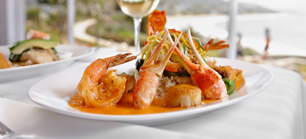 Golf Ahoy Danube River Golf Cruise AmaMagna crab claws prawns and scallops on a white plate