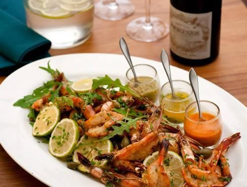 2023 South Africa Coastal Golf Cruise Polana Hotel cold beer and peri-peri prawn platter.