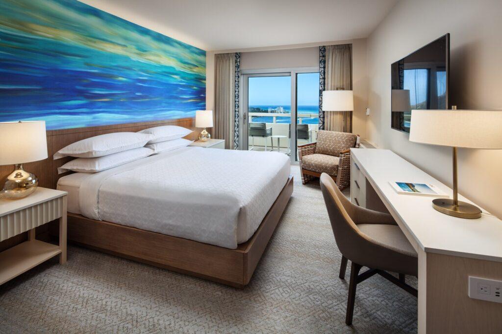 GolfAhoy Hawaii Golf Cruises photo king bedroom interior at the Sheraton Waikiki Beach Resort.